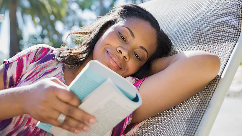 Woman with XLH relaxing and reading